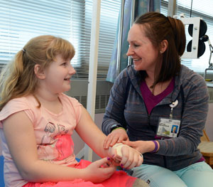 physical therapist treating child's arm