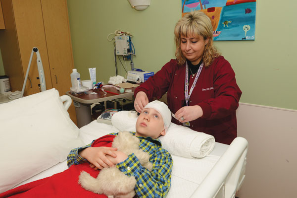 EEG tech wraps gauze around child's head