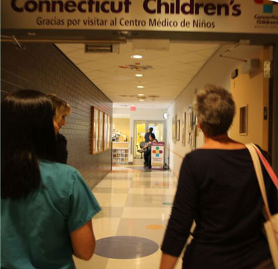patient and child exiting the building