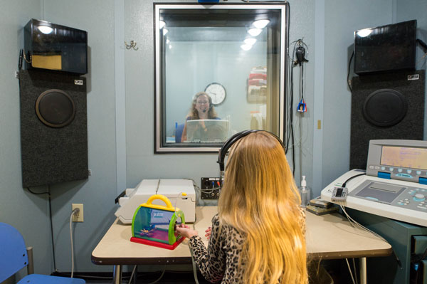 play hearing test - behind glass