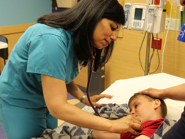 nurse listening to child's heart