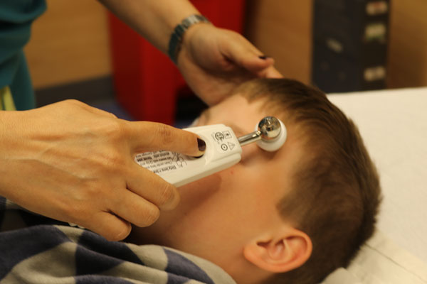 nurse taking child's temperature