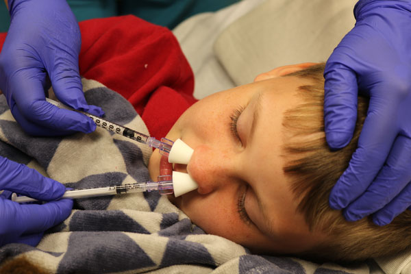 sedation syringe being applied to nose