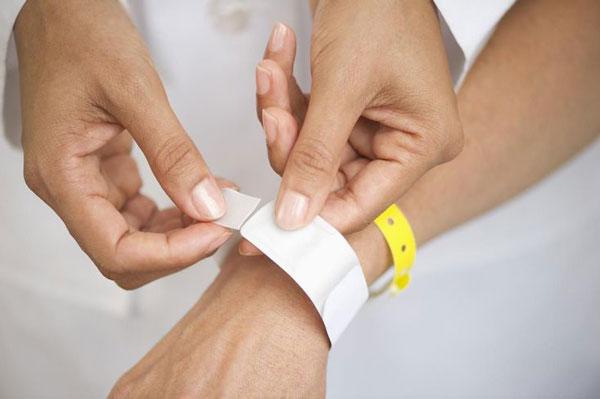 putting medical bracelets on