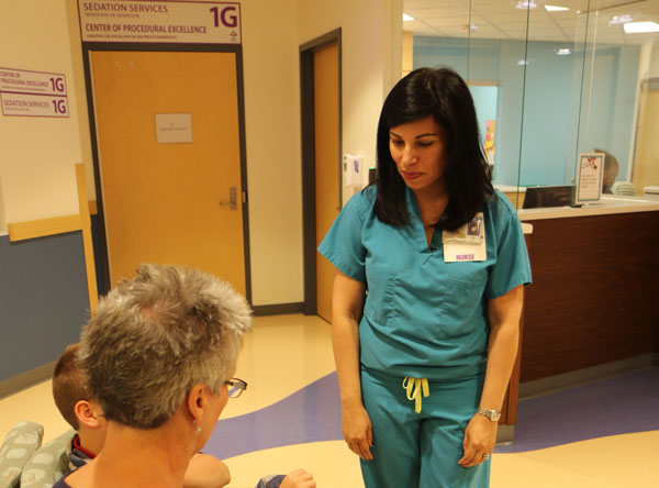nurse greeting patient and parent