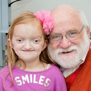 "Emma with Neurosurgeon Paul Kanev, MD (""Dr. Paul"")"