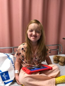 emma smiling after surgery