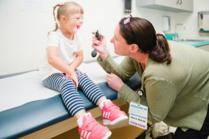 Physician assistant examines patient