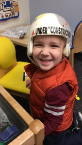 James wearing in construction helmet