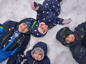 Maddison and her three brothers playing in the snow