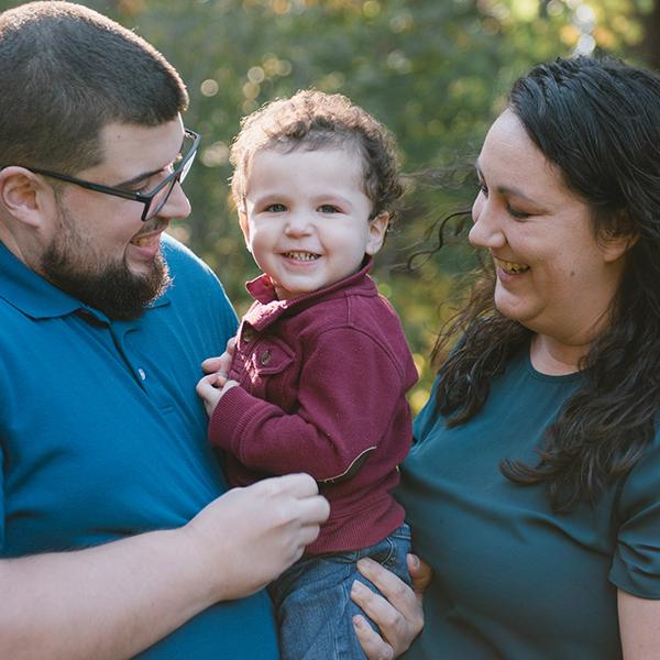 Marie and Josh Pinheiro hold their son, Fredrik