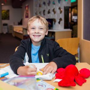 Child creates coping bag during Needlephobia Open House at UTC Family Resource Center