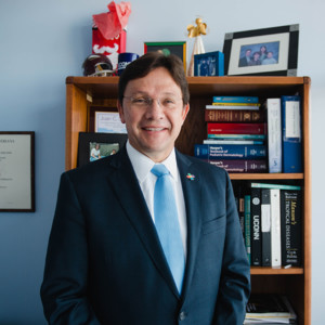 Juan Salazar, MD, physician-in-chief at Connecticut Children's, stands in his office