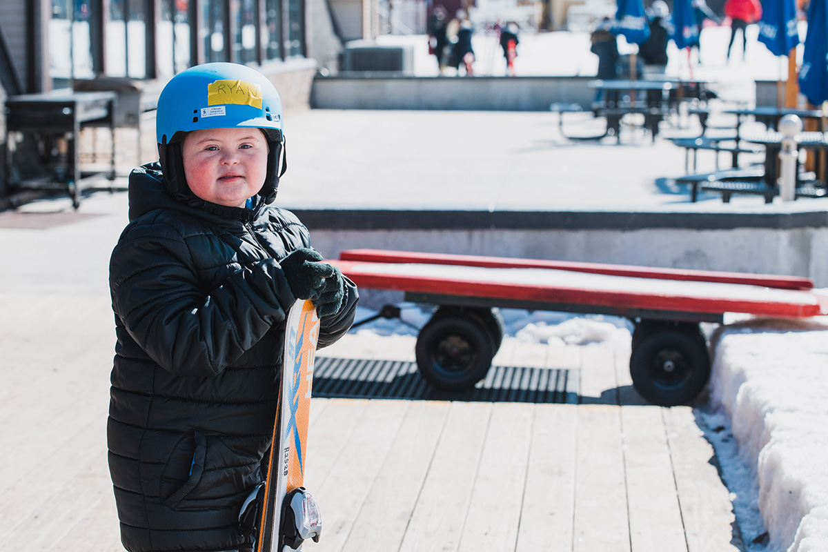 Ryan, a participant in the Skiers Unlimited Program, gets ready to ski