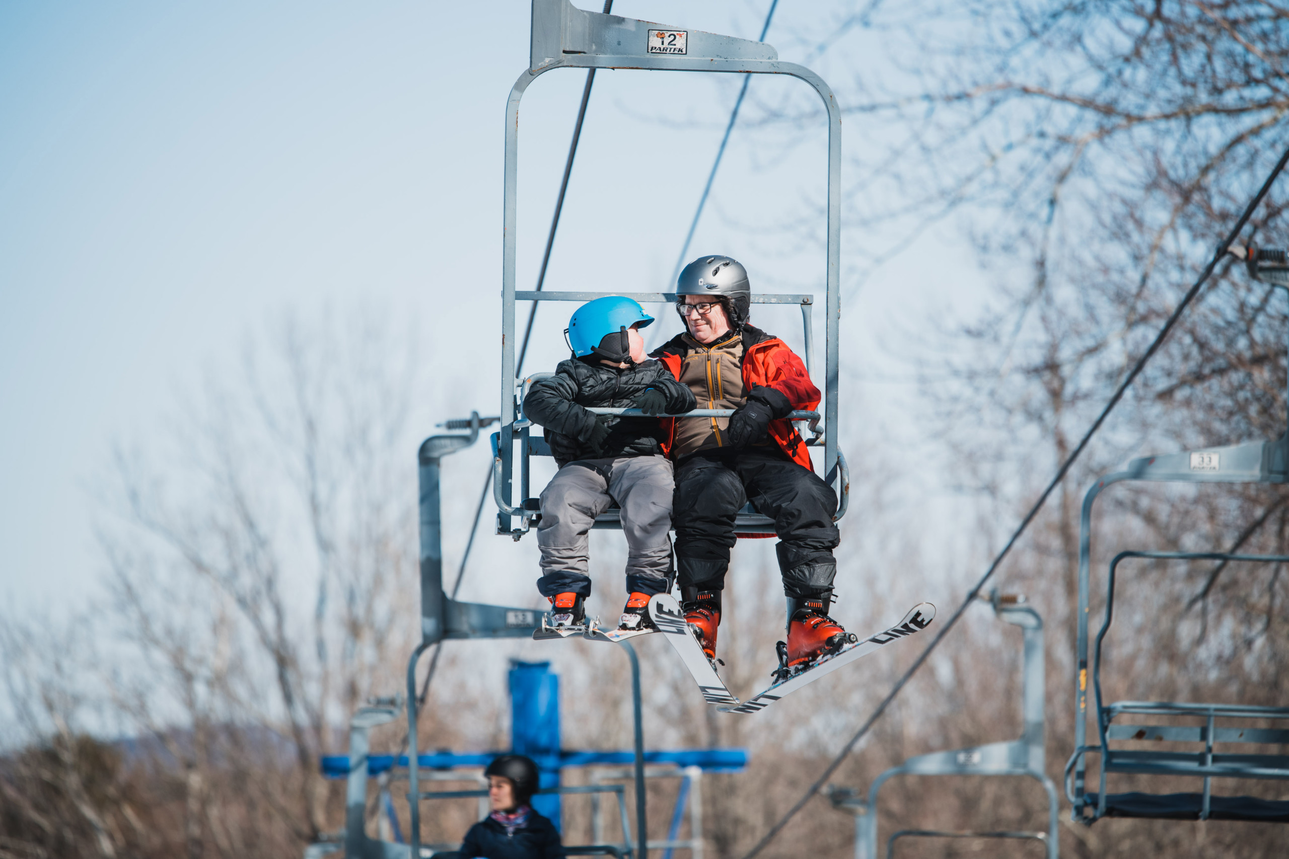 Ryan rides the chairlift with one of his instructors in the Skiers Unlimited program