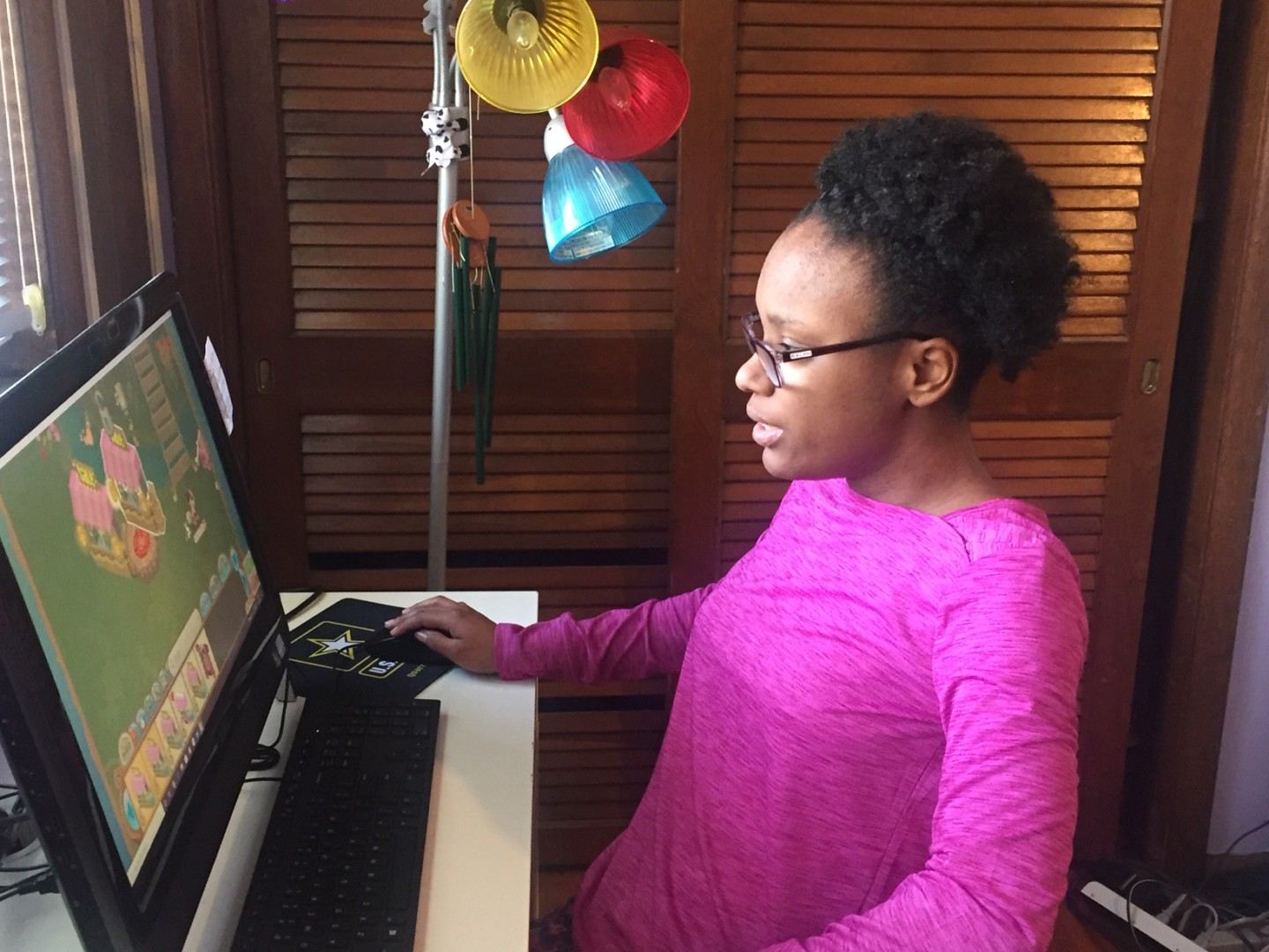 Patient Lauryn sits in front of her computer, ready for a Video Visit