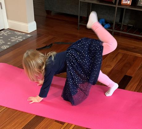 Dr. Ayr-Volta's daughter practices yoga