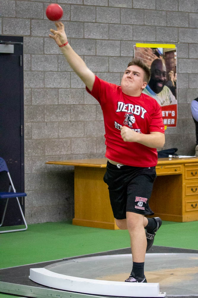Michael, a patient, throwing a shot put at the state championship