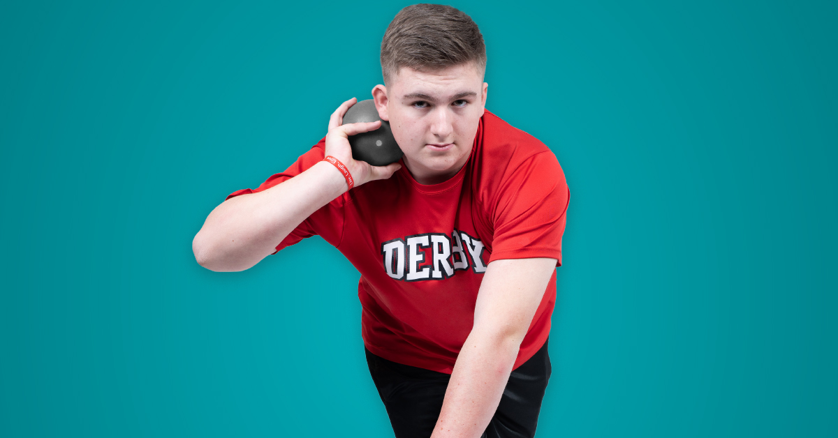 Michael, a patient, gets ready to throw a shot put