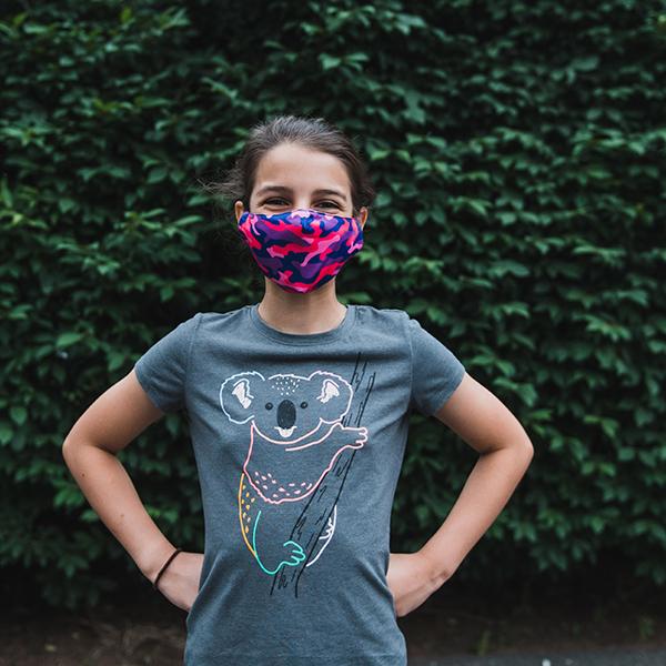 Preteen wearing a face mask