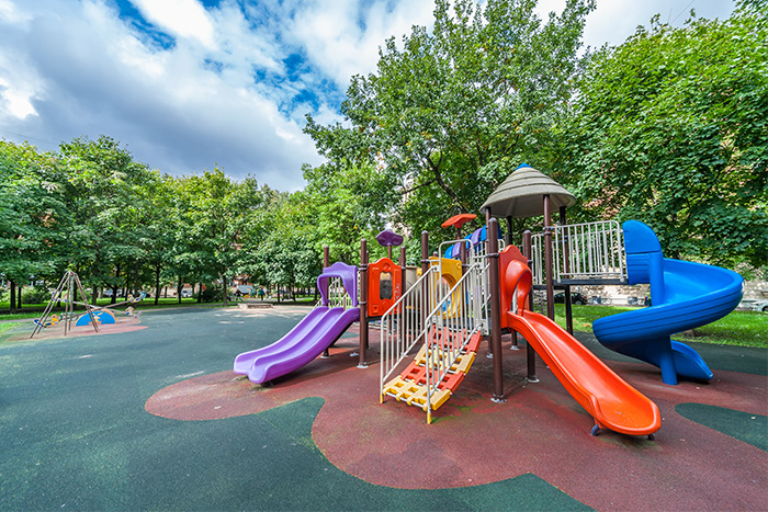 Empty, colorful playground with three slides