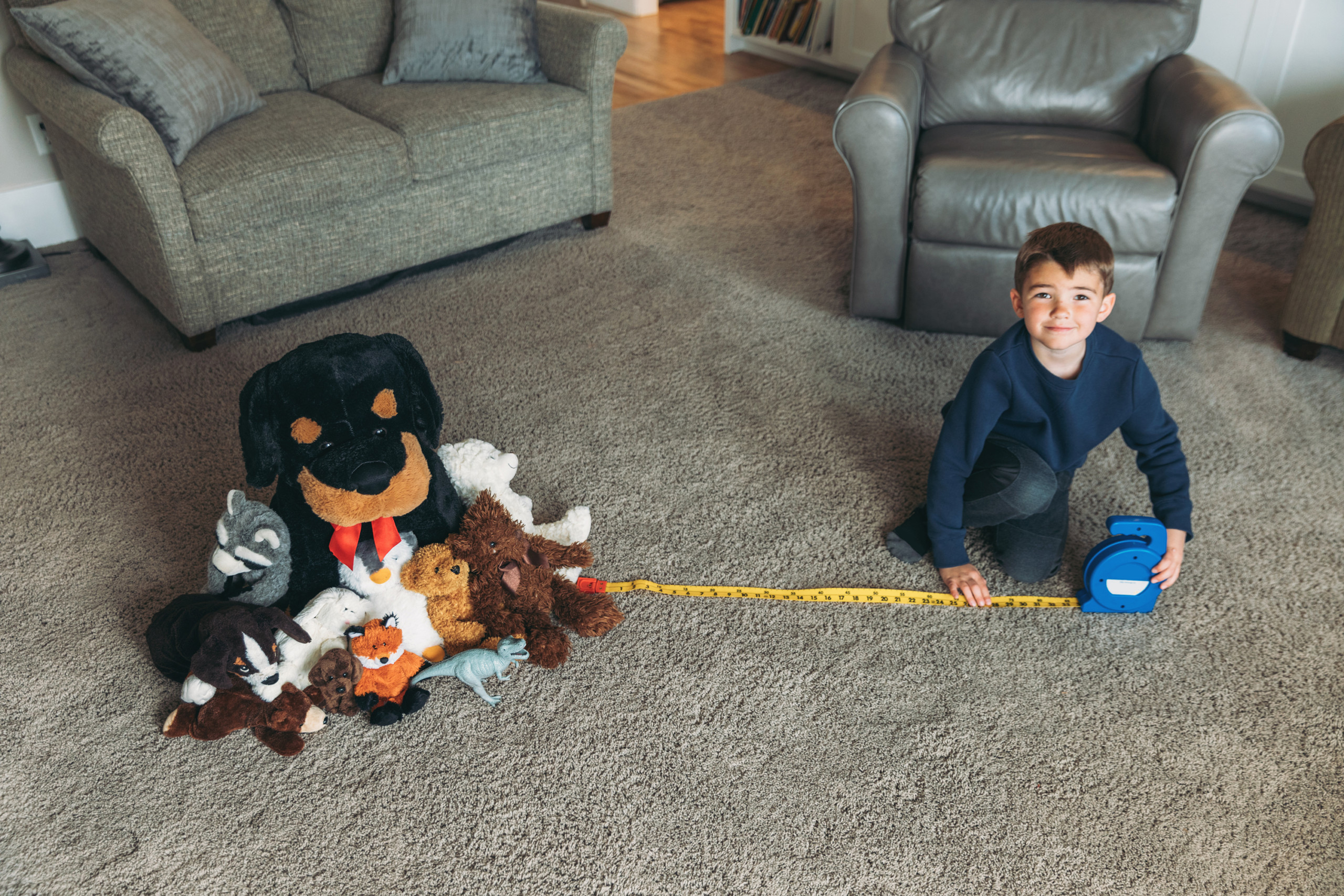 School-age child practices social distancing with stuffed animals