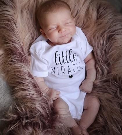 "Baby Delilah wearing ""Little Miracle"" onesie"