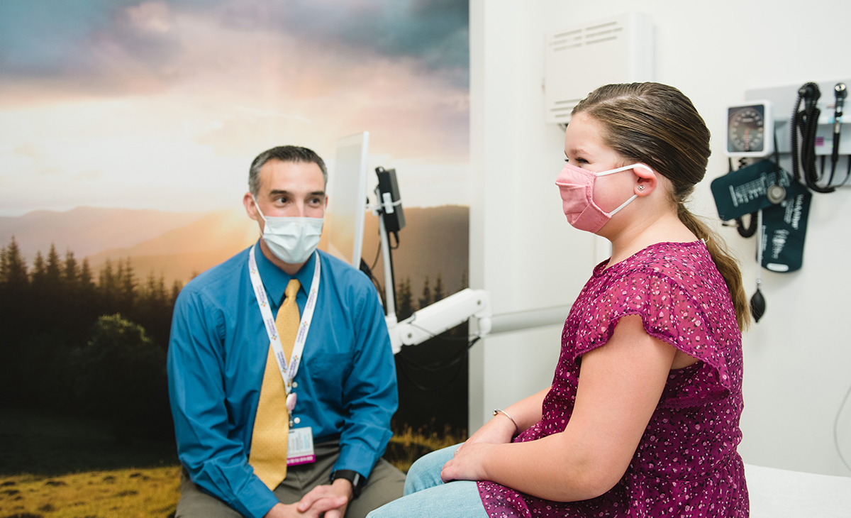 Williams Yorns, Jr., MD, visits with one of his patients, Morgan