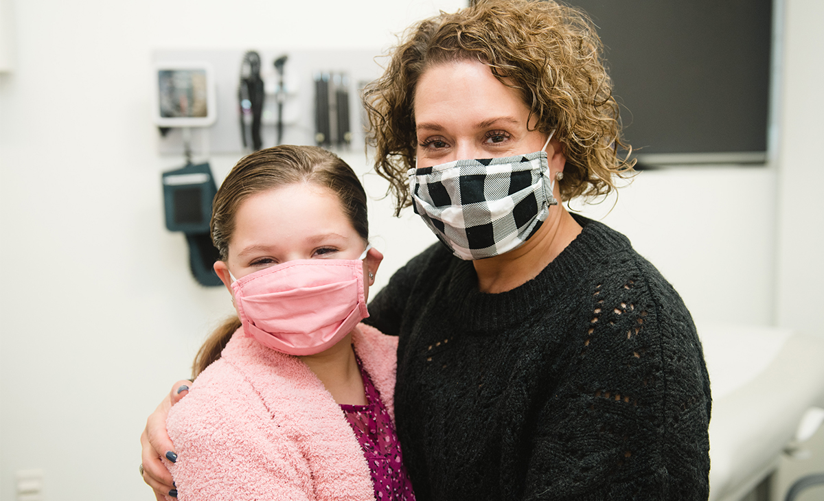 Morgan, a patient in nephrology, neurology and cardiology, poses for a photo with her mom.