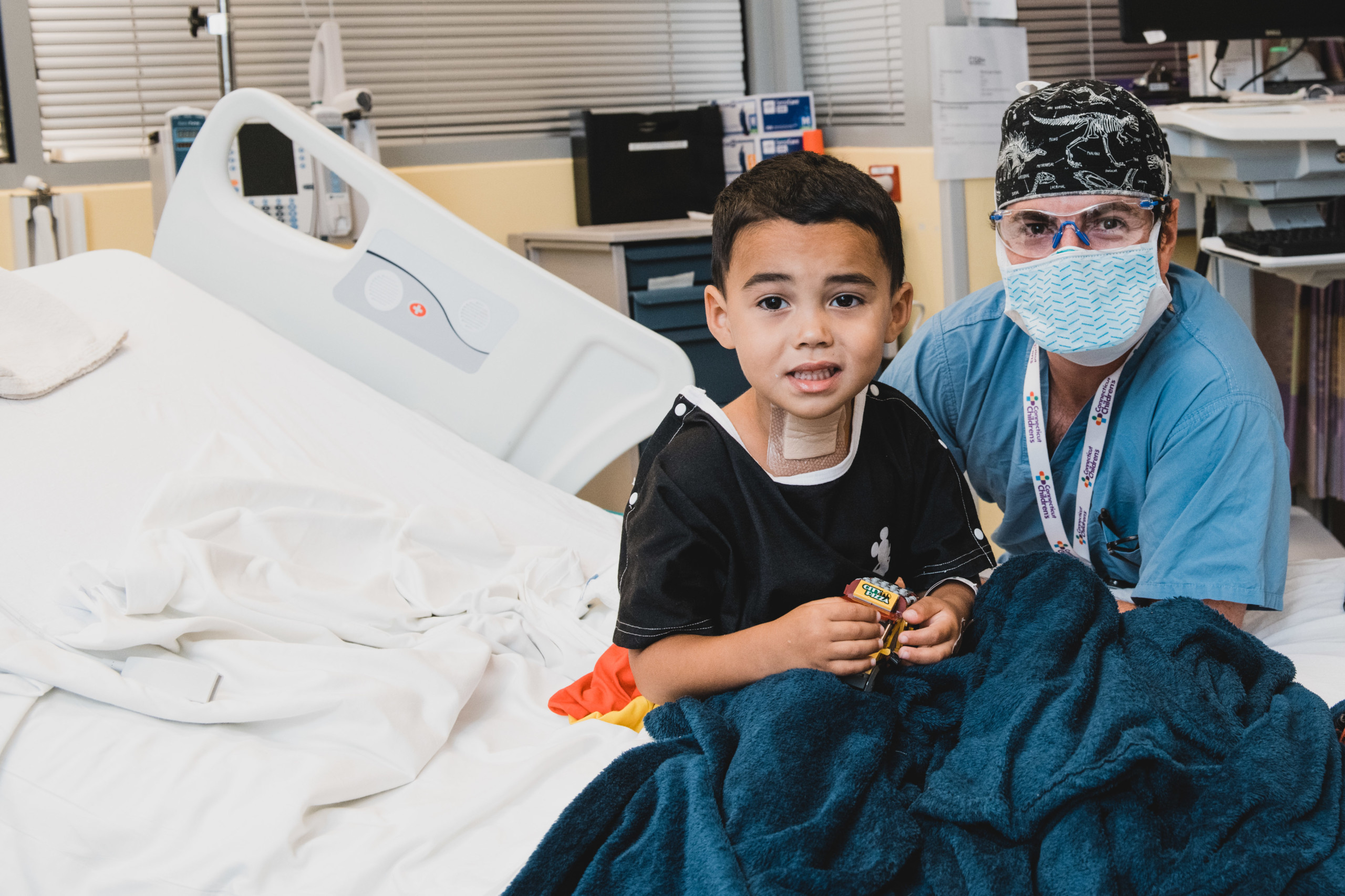 Patient Cameron Soto poses with ENT specialist Christopher Grindle, MD, after Cameron had his tracheotomy removed
