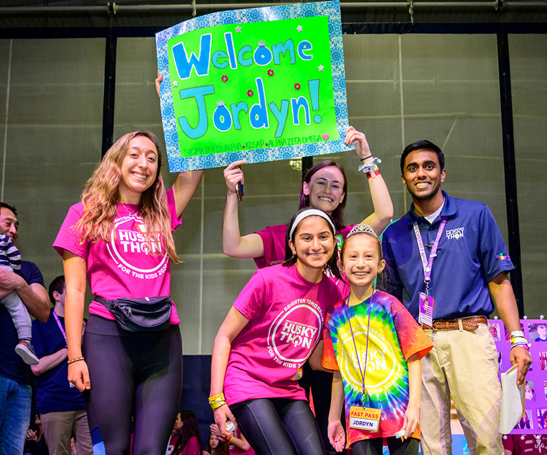 Jordan Ty, Connecticut Children's 2021 Children's Miracle Network Hospital Champion Child, wears a tie-dye shirt while participating in HuskyTHON