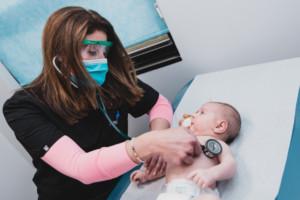Dr. Hoberman listening to child's heart