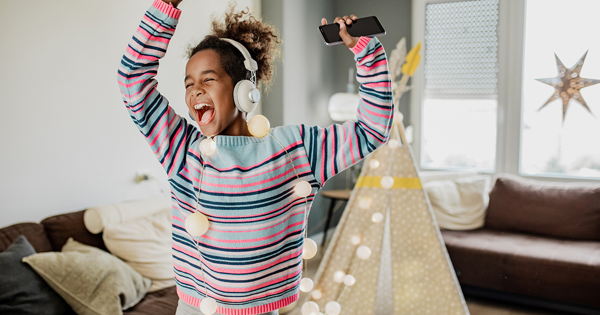 Preteen girl having a dance party at home
