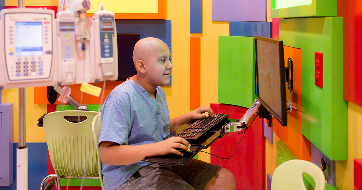 Youssef, a patient in Cancer and Blood Disorders, uses a computer in the Lion's Den