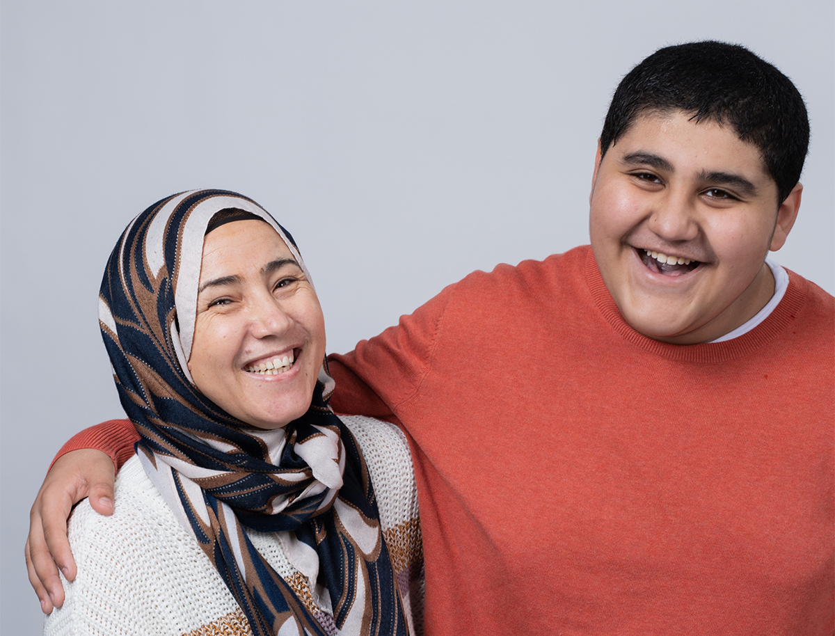 Youssef, a patient in Cancer and Blood Disorders, poses for a photo with his mom