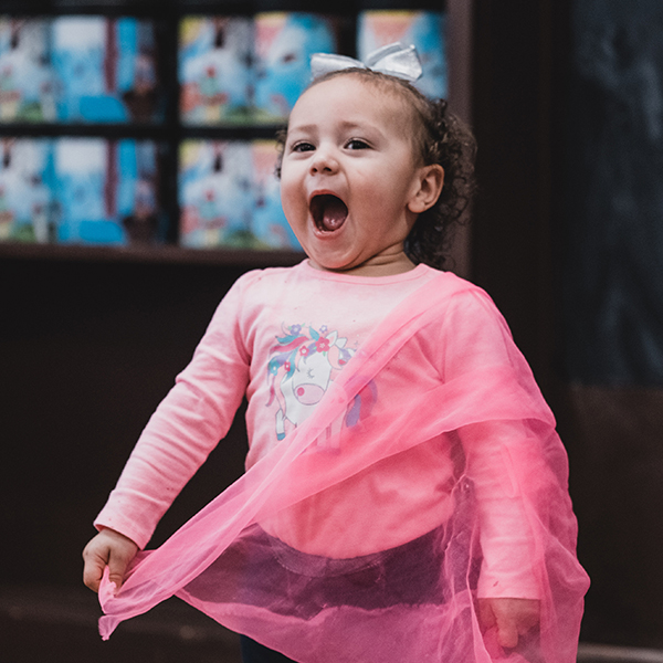 Toddler participating in a Zumbini class