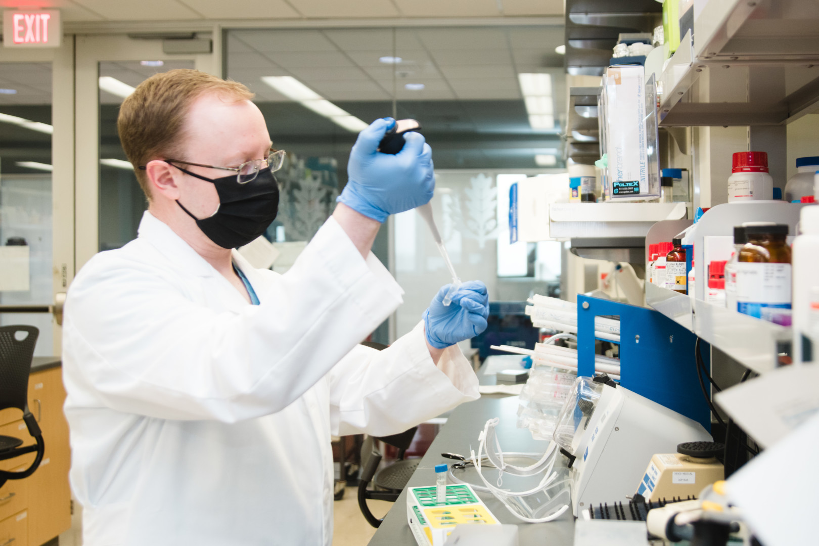 Dr. Bookland experimenting in neurosurgery lab