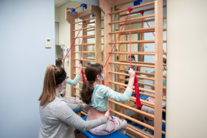 physical therapist working with a patient with scoliosis