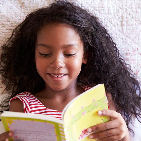 School age child reading a book