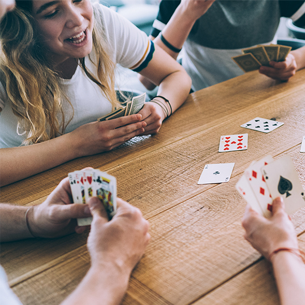 A group of friends playing a card game
