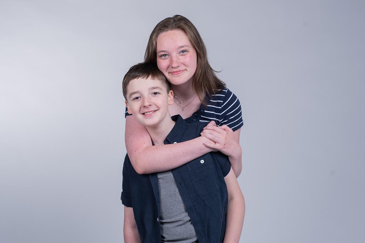 Delaney hugs her brother Danny